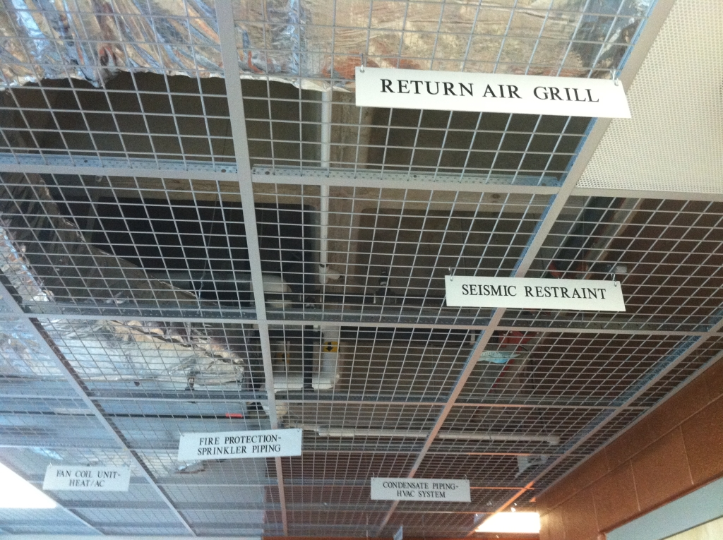 PCTA ceiling signage - ducts, plumbing etc. compressed